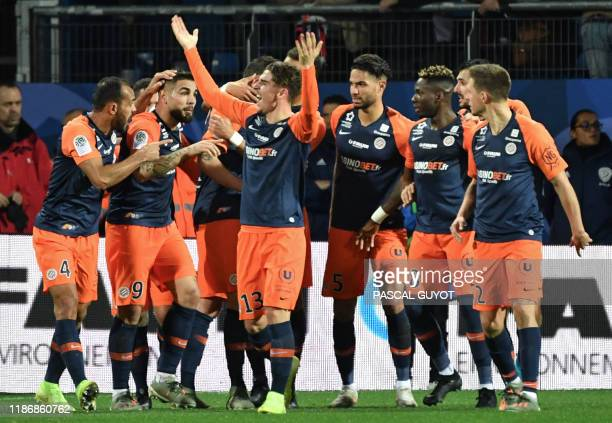 Montpellier's players celebrate after scoring a goal during the French L1 football match between Montpellier Herault Sport Club and Paris...