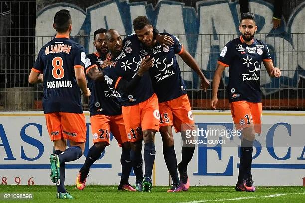 Montpellier's players celebrate after scoring a goal during the French L1 football match between Montpellier and Marseille at the La Mosson Stadium...