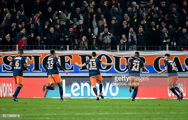Montpellier's players celebrate after scoring a goal during the French Ligue 1 football match between MHSC Montpellier and Paris Saint Germain on...