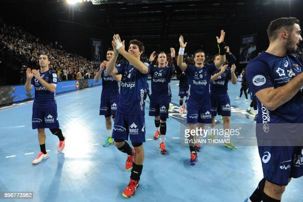 Montpellier's players celebrate after winning the French D1 handball match between Montpellier and Paris at Sud de France Arena on December 21 2017...
