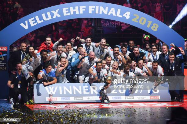 Montpellier's players celebrate with the trophy after winning the Final match HBC Nantes vs HB Montpellier at the EHF Pokal men's Champions League...