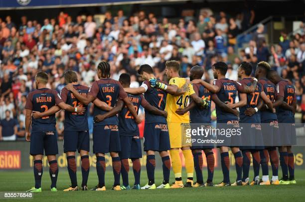 Montpellier's players observe a minute silence in tribute to the victims of Barcelone's attack prior to the French L1 football match between...
