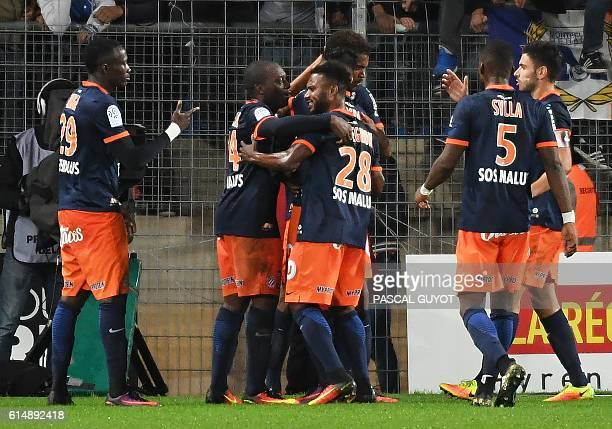 Montpellier's players react after scoring a goal during the French L1 football match between Montpellier and Caen on October 15 2016 at the la Mosson...