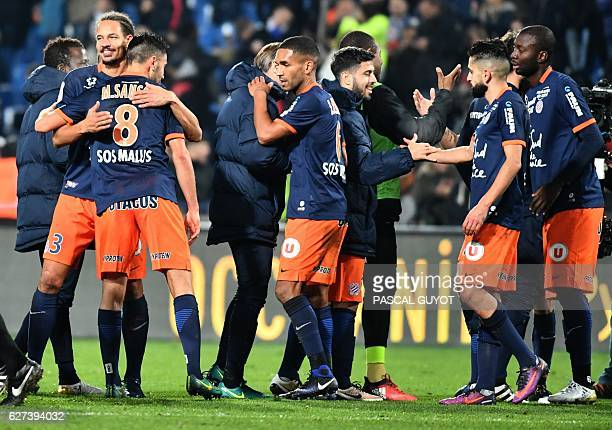 Montpellier's players react after winning against Paris SaintGermain during the French L1 football match between MHSC Montpellier and Paris...