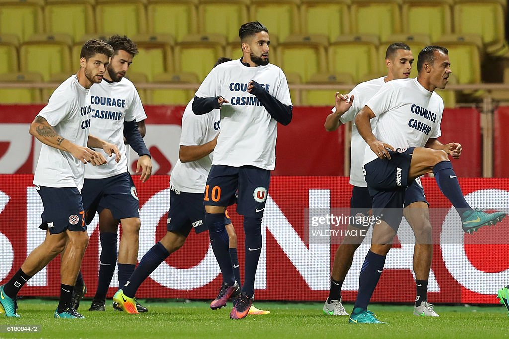 Montpellier's players warm up prior to the French L1 football match between AS Monaco and Montpellier at the Louis II Stadium in Monaco on October 21, 2016. / AFP / VALERY