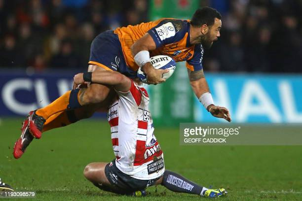 TOPSHOT Montpellier's Samoan scrumhalf Kahn Fotuali'i is tackled during the European Rugby Champions Cup pool 5 rugby union match between Gloucester...
