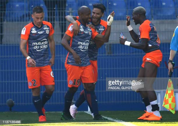 Montpellier's Senegalese forward Souleymane Camara is congatulated by his team mates after scoring a goal during the French L1 football match between...