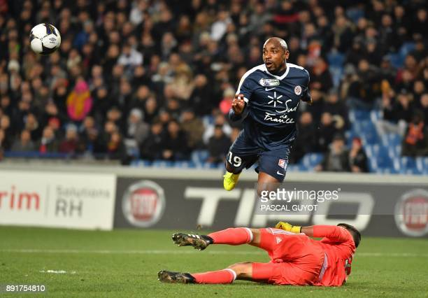 Montpellier's Senegalese forward Souleymane Camara vies with Lyon's French goalkeeper Mathieu Gorgelin during the French League Cup round of 16...