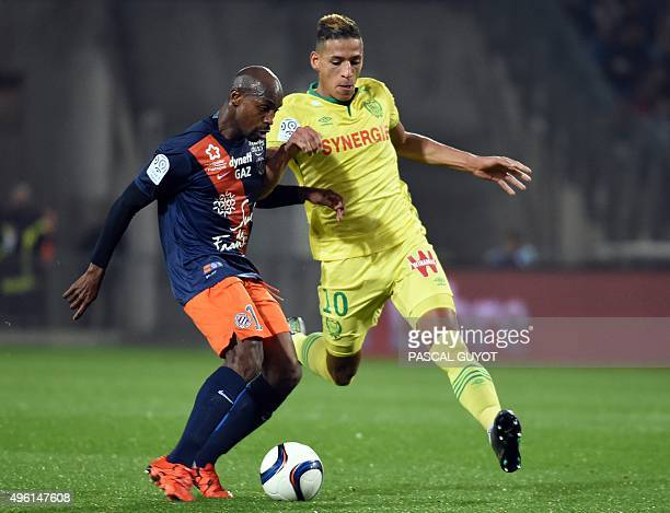 Montpellier's Senegalese forward Souleymane Camara vies with Nantes' French forward Yacine Bammou during the French L1 football match between MHSC...