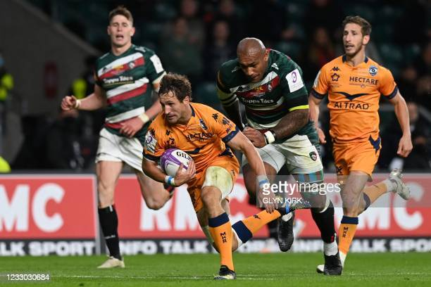Montpellier's South African centre Johan Goosen runs in a try during the European Rugby Challenge Cup final between Leicester Tigers and Montpellier...