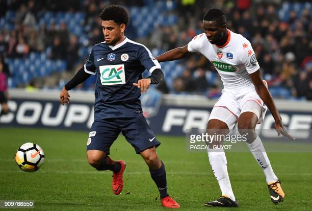 Montpellier's South African forward Keagan Dolly vies with Lorient's French defender Ibrahima Conte during the French Cup round of 16 football match...