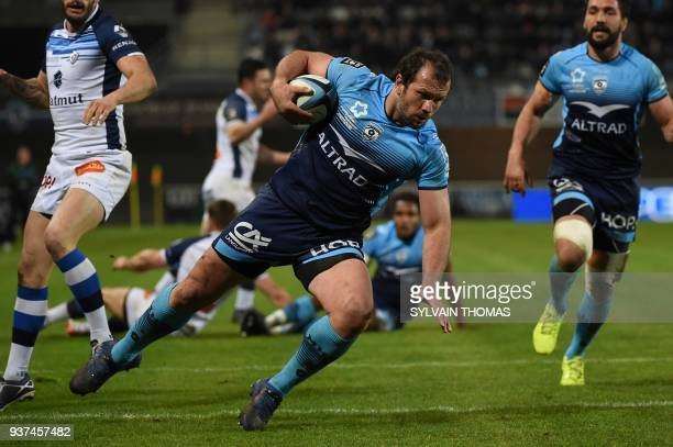 Montpellier's South African hooker Bismarck Du Plessis scores a try during the French Top 14 rugby union match between Montpellier and Castres on...
