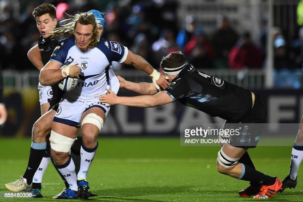 Montpellier's South African lock Jacques Du Plessis is tackled by Glasgow Warriors' Scottish lock Scott Cummings during the European Champions Cup...