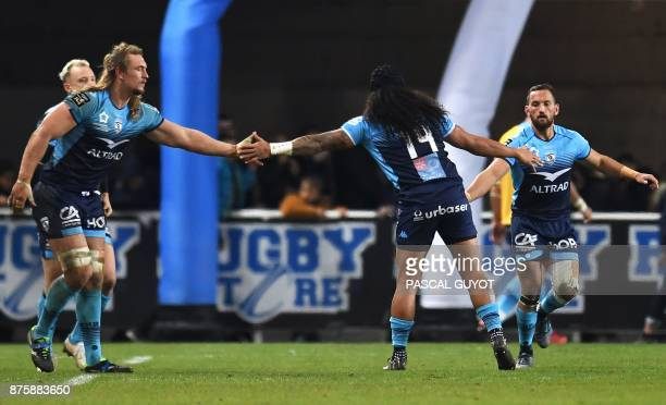 Montpellier's South African lock Jacques Du Plessis shakes hands with New Zealander number eight Joseph Tomane and New Zealander fly half Aaron...