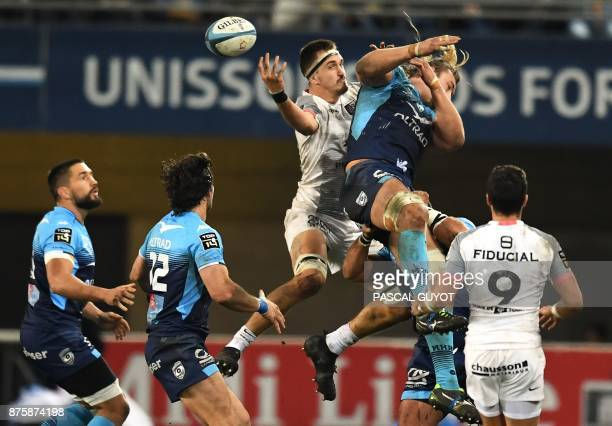 Montpellier's South African lock Jacques Du Plessis vies with Toulouse's French lock Florian Verhaeghe during the French Top 14 rugby union match...