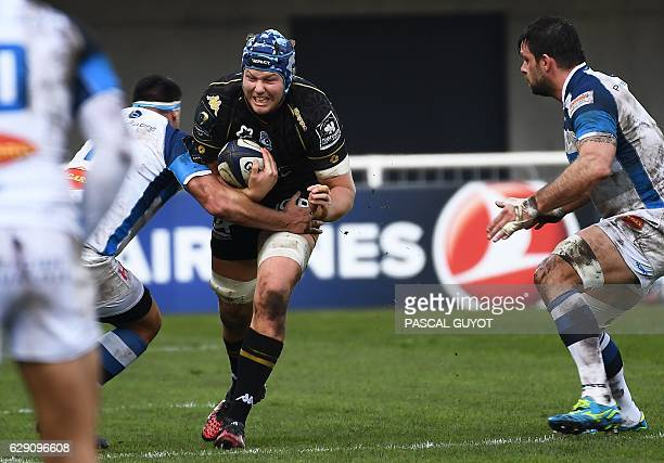 Montpellier's South African Lock Nicolaas Van Rensburg runs with the ball during the European Champions Cup rugby union match between Montpellier and...