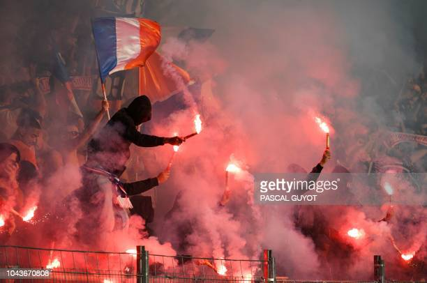 Montpellier's supporters react during the French L1 football match between Montpellier and Nimes on September 30 2018 at the the Mosson stadium in...