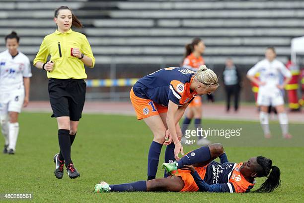 Montpellier's Swedish forward Josefine Oqvist checks on her teammate forward Marina Makanza lying injured on the ground during the French Women's...
