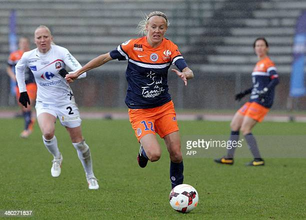Montpellier's Swedish forward Josefine Oqvist is challenged by Juvisys French defender Nelly Guilbert during the French Women's Division 1 football...