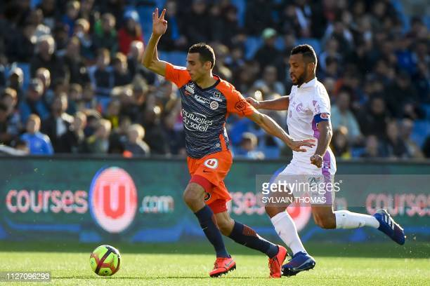 Montpellier's Tunisian defender Ellyes Skhiri vies with Reim's French defender Jacques Romao during the French L1 football match between Montpellier...
