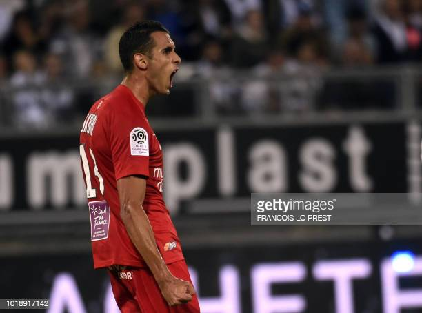 Montpellier's Tunisian midfielder Ellyes Skhiri celebrates after scoring during the French L1 football match between Amiens and Montpellier at The...