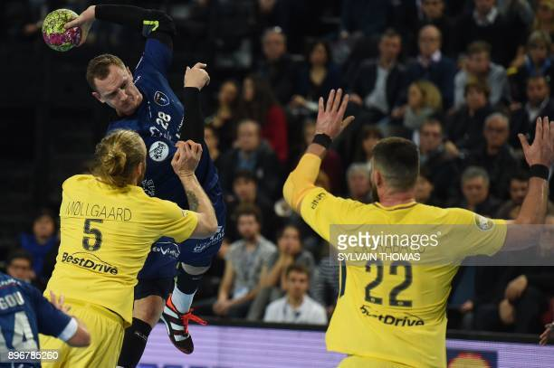 Montpellier's Valentin Porte takes a shot during the French D1 handball match between Montpellier and Paris at Sud de France Arena on December 21...