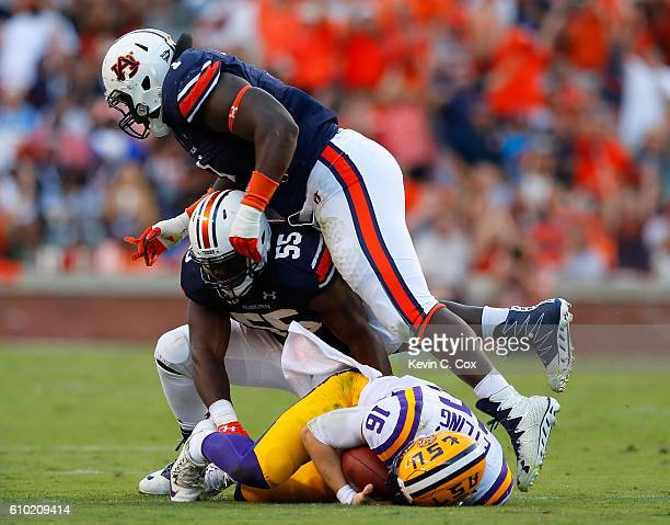 Montravius Adams of the Auburn Tigers tries to leap up after Carl Lawson sacked Danny Etling of the LSU Tigers at JordanHare Stadium on September 24...