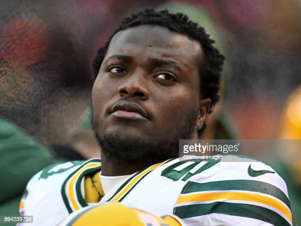 Montravius Adams of the Green Bay Packers watches the action from the sideline in the fourth quarter of a game on December 10 2017 against the...