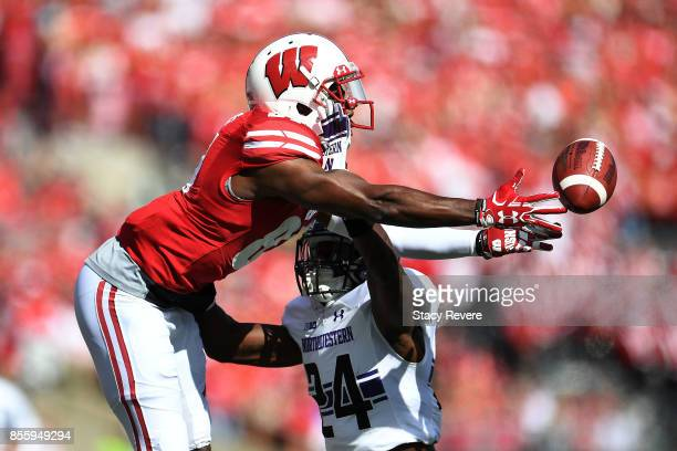 Montre Hartage of the Northwestern Wildcats defends a pass intended for Quintez Cephus of the Wisconsin Badgers during the first quarter of a game at...