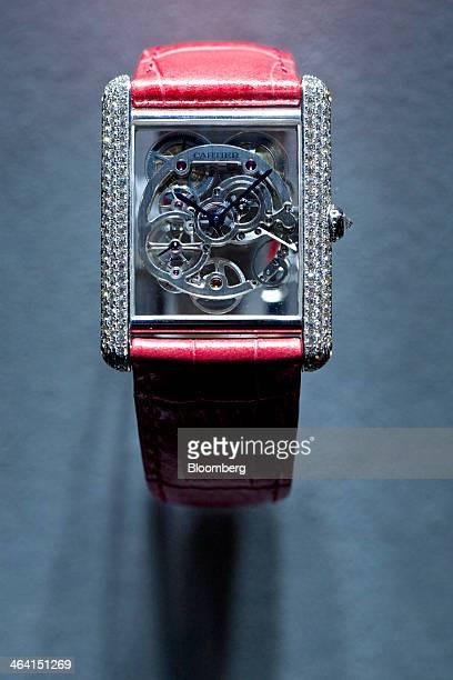 A Montre Tank Louis Cartier Squelette Saphir luxury wristwatch manufactured by Cartier a luxury unit of Cie Financiere Richemont SA sits on display...