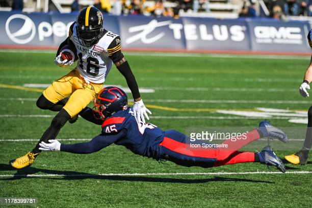 Montreal Alouettes cornerback Najee Murray tackles Hamilton Tiger-Cats wide receiver Brandon Banks during the Hamilton Tiger Cats versus the Montreal...