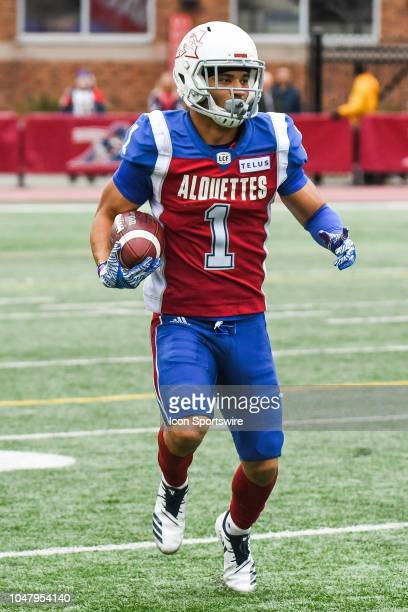 Montreal Alouettes Defensive back Branden Dozier runs with the ball after an interception during the Calgary Stampeders versus the Montreal Alouettes...
