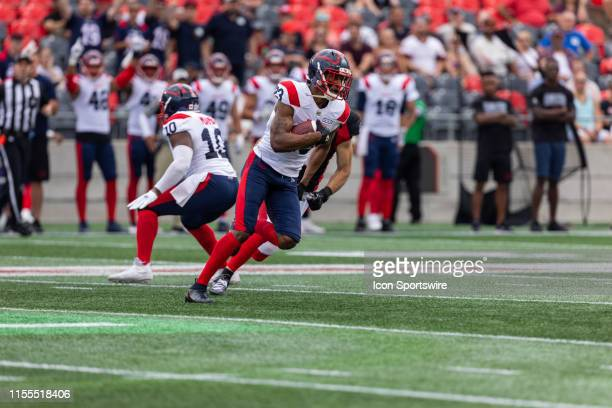 Montreal Alouettes defensive back Tommie Campbell runs with the football during Canadian Football League action between the Montreal Alouettes and...