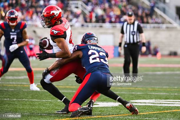 Montreal Alouettes defensive back Tommie Campbell tackles Calgary Stampeders wide receiver Eric Rogers during the Calgary Stampeders versus the...