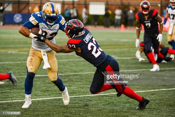 Montreal Alouettes Defensive back Tommie Campbell tackles Winnipeg Blue Bombers Running back Andrew Harris during the Winnipeg Blue Bombers versus...