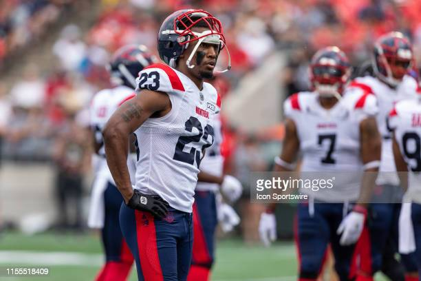 Montreal Alouettes defensive back Tommie Campbell with his helmet up as he waits for play to resume during Canadian Football League action between...