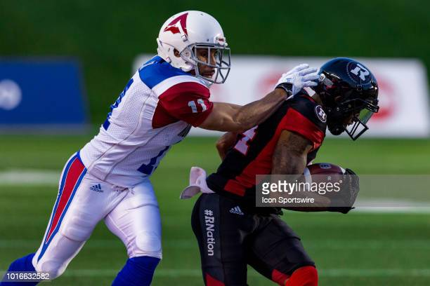 Montreal Alouettes linebacker Chip Cox tries to get a hold of Ottawa Redblacks wide receiver RJ Harris during Canadian Football League action between...