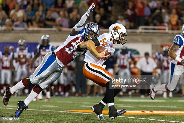 Montreal Alouettes linebacker Kyries Hebert tackles BC Lions quarterback Travis Lulay during a CFL game between the BC Lions and the Montreal...