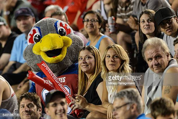 Montreal Alouettes' mascot Touche sits with fans during the CFL game between the Montreal Alouettes and the Ottawa Redblacks at Percival Molson...