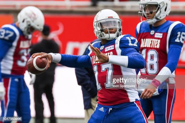 Montreal Alouettes Quarterback Antonio Pipkin passes the ball at warmup before the Calgary Stampeders versus the Montreal Alouettes game on October 8...