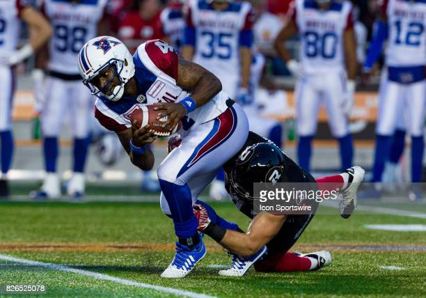 Montreal Alouettes quarterback Darian Durant attempts to avoid being sacked during Canadian Football League action between Montreal Alouettes and...