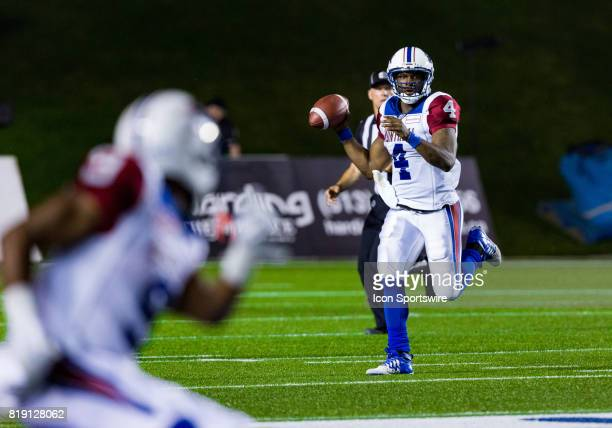 Montreal Alouettes quarterback Darian Durant looks for a receiver downfield as he scrambles out of the pocket during Canadian Football League action...