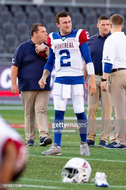 Montreal Alouettes quarterback Johnny Manziel takes a second during warmup before Canadian Football League action between the Montreal Alouettes and...