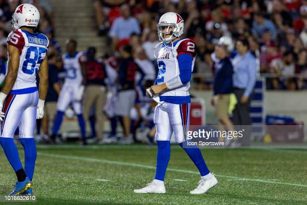 Montreal Alouettes quarterback Johnny Manziel wipes his hands as there is a stoppage during Canadian Football League action between the Montreal...