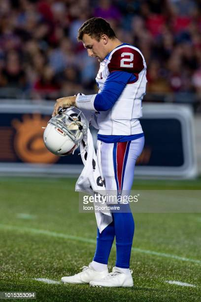 Montreal Alouettes quarterback Johnny Manziel wipes his helmet as there is a stoppage during Canadian Football League action between the Montreal...