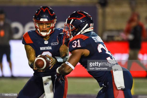 Montreal Alouettes Quarterback Vernon Adams Jr hands the ball off to Montreal Alouettes Running Back William Stanback during the BC Lions versus the...