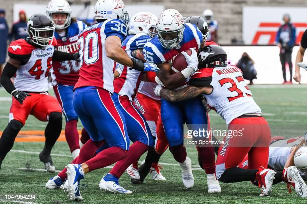 Montreal Alouettes Running back Lawrence Pittman gets tackled during the Calgary Stampeders versus the Montreal Alouettes game on October 8 at...