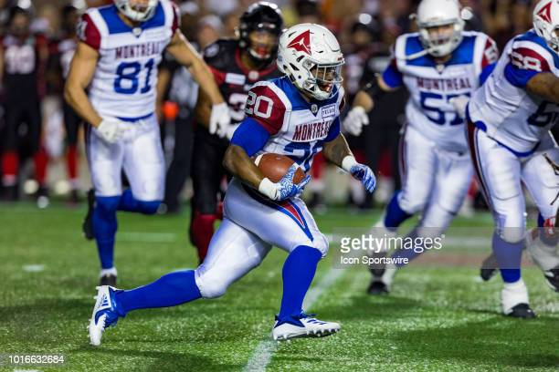 Montreal Alouettes running back Tyrell Sutton runs with the football during Canadian Football League action between the Montreal Alouettes and Ottawa...