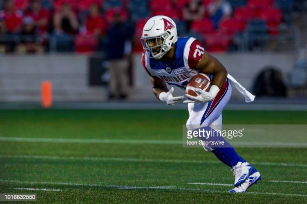 Montreal Alouettes running back William Stanback returns a kick during Canadian Football League action between the Montreal Alouettes and Ottawa...