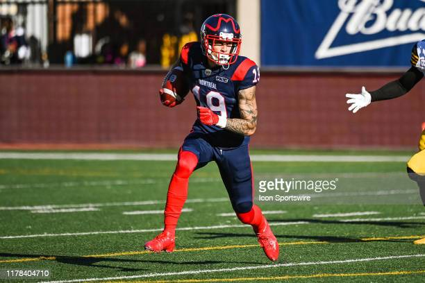 Montreal Alouettes wide receiver Dante Absher runs with the ball during the Hamilton Tiger Cats versus the Montreal Alouettes game on October 26 at...